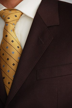 Men's Brown Suit with Golden Tie Close-up